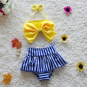Novedosa ropa de baño niña dos piezas amarillo con azul