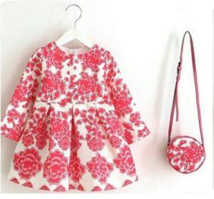 Conjunto vestido con cartera color rosado