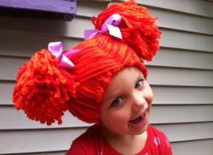 Gorro peluca de lana con moños color naranja