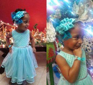 Hermosa niña luciendo una vincha color celeste